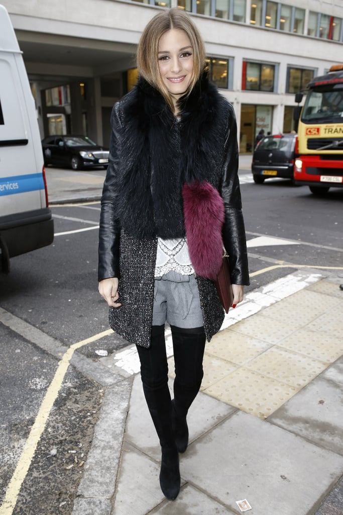 Olivia dared to wear shorts in Winter by pairing the leg-baring style with tall boots and a tweed-and-leather coat.