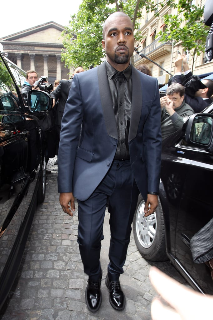 Kanye wore a blue suit.