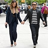 They held hands while walking through NYC.
