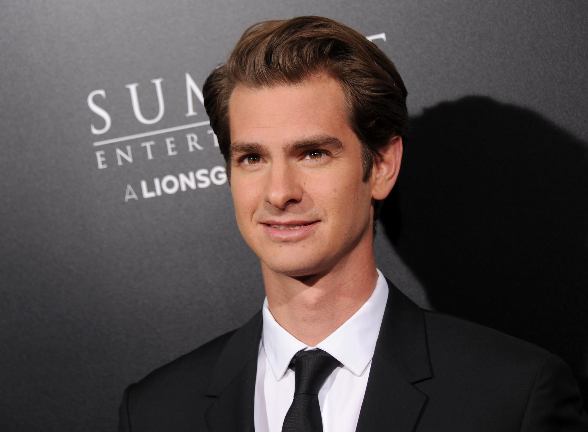 Watch Andrew Garfield is facing criticism for claiming to be a gay man just without the physical stuff' video