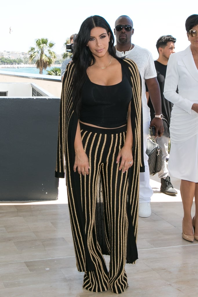 """Kim styled her Autumn 2015 Balmain set with her dainty """"Nori"""" necklace, her engagement ring, and simple black sandals."""