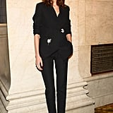Alexa Chung wore a chic black suit to the event.