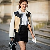 Dress up a miniskirt-and-tee combo by draping a jacket over your shoulders.
