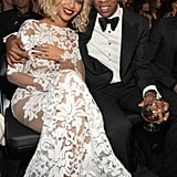Beyoncé and Jay Z stayed close in their front-row seats at the Grammys in January 2014.