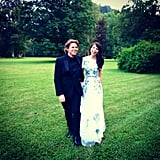 After a costume change, Sieber joined her gown's designer, Christopher Kane, for a stroll in the field. Source: Instagram user derekblasberg