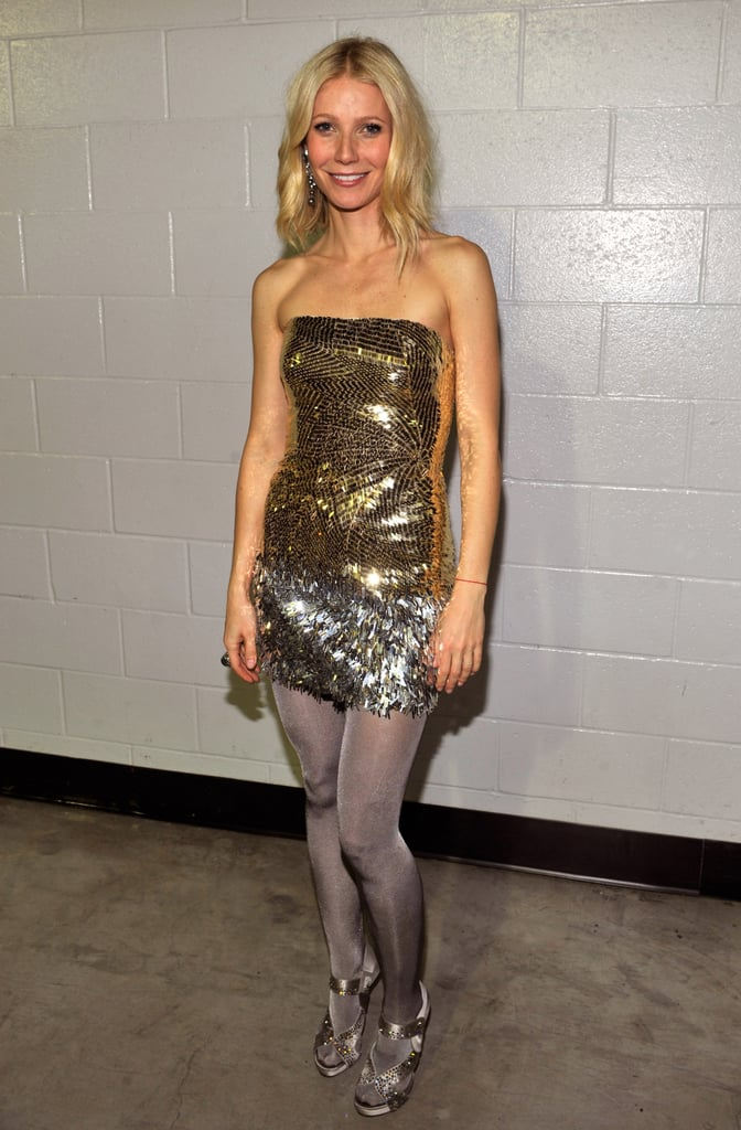 Gwyneth dazzled in a gold and silver Versace mini, sparkling tights, and embellished sandals at the 51st Annual Grammys.