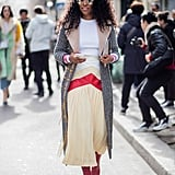 For a Pop of Color, Style Your Midi Skirt With Red Boots