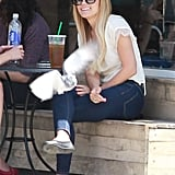 Lauren Conrad and a friend had a laugh at a table outside of Starbucks in LA.