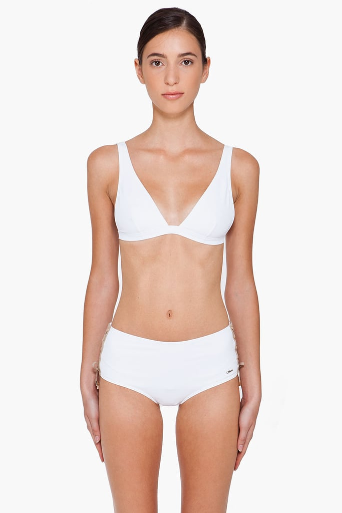 Just think how amazing this little white bikini will look with your glowing tan — the boy shorts are also great for playing up curves on a smaller frame.  Chloé White Side-Tie Swimsuit ($550)