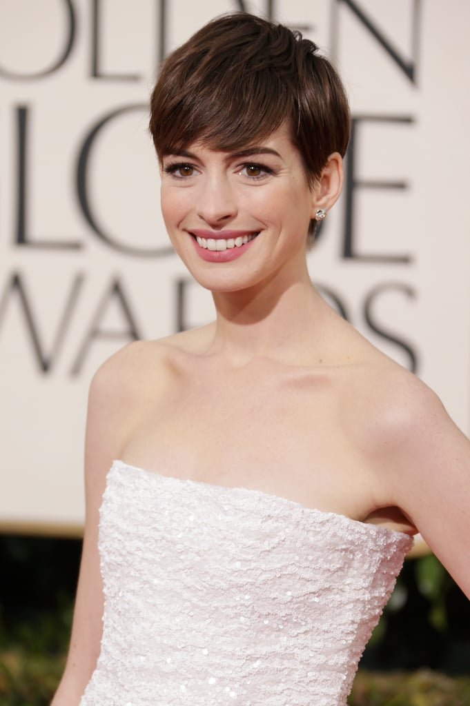Anne Hathaway smiled for the cameras.