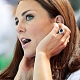 Kate Middleton fixed her hair.