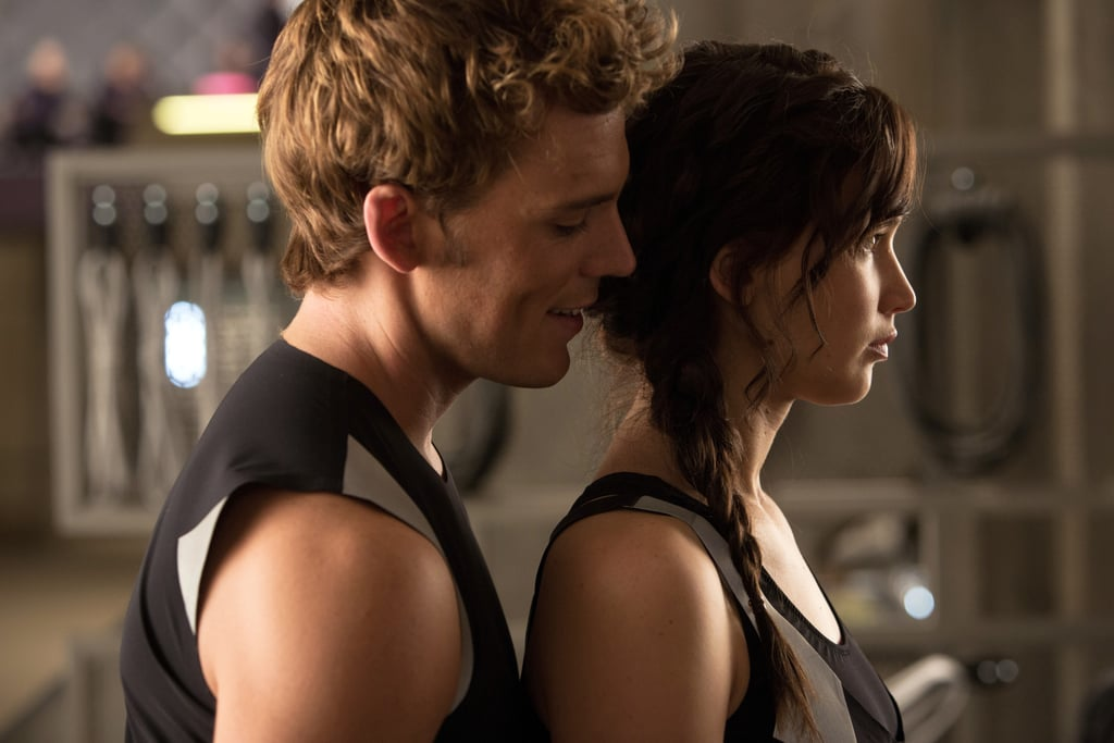 Sam Claflin as Finnick and Jennifer Lawrence as Katniss in Catching Fire.