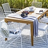 MoDRN Industrial Wrought-Iron Stacking Dining Chair and Teak Patio Dining Table