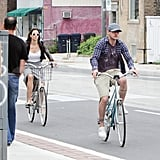 Justin Timberlake riding bikes with Jessica Biel.
