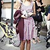 Mary Kate Steinmiller proved pretty dresses look even cooler with a sporty-chic angle via Lanvin high-tops and an oxblood varsity jacket in tow. Source: Greg Kessler