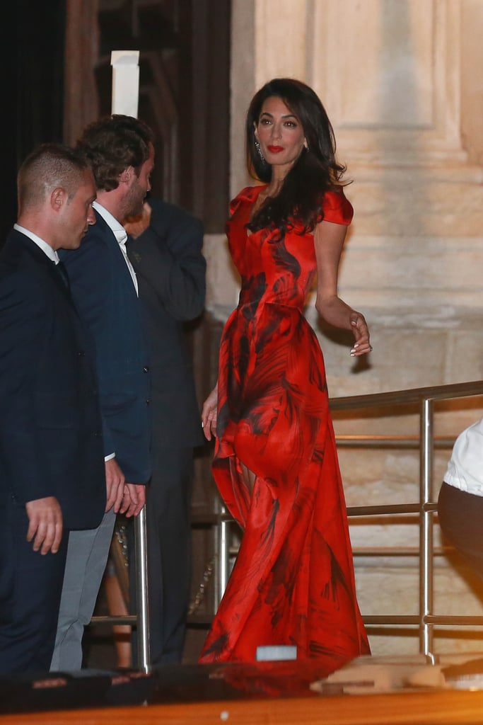 b9bf7f4a39dd Amal wore Alexander McQueen for her wedding weekend in Venice in 2014. She  models a
