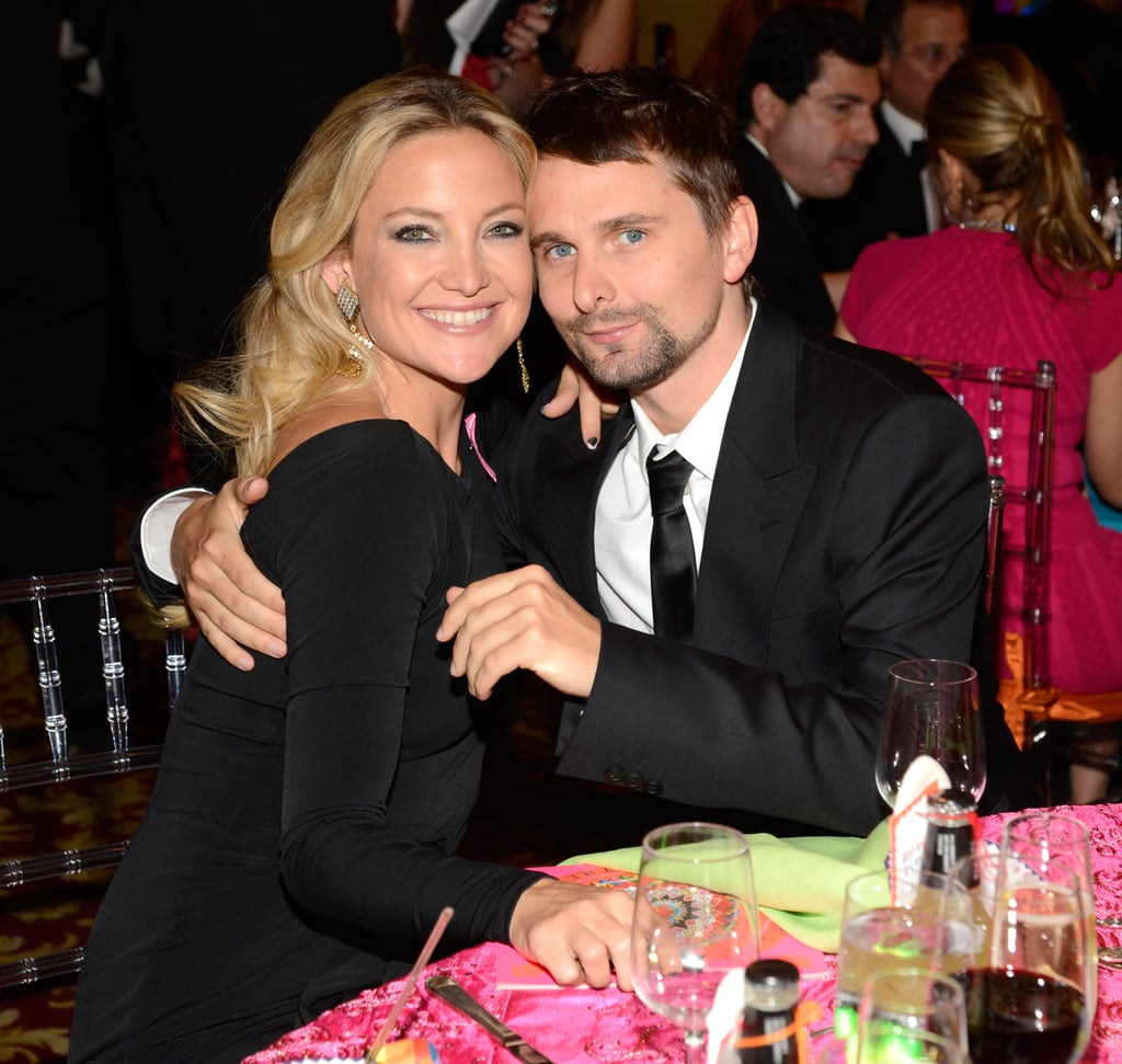 Kate Hudson and Matthew Bellamy cuddled up inside the party.