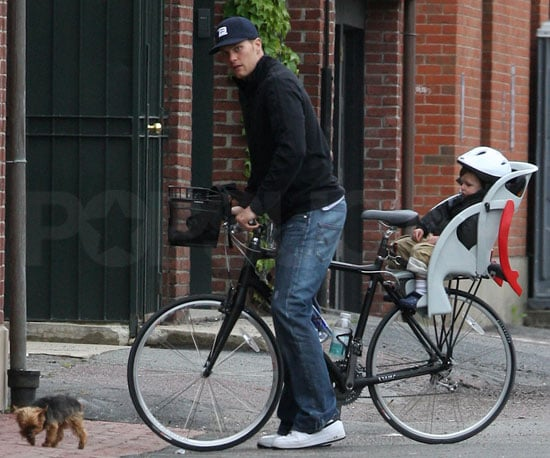 Slide Photo of Tom Brady Riding His Bike With Baby Jack in Massachusetts