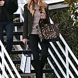 Just when you think Rosie Huntington-Whiteley can't get anymore stylish, she goes and pairs a green blazer with a leopard-printed Céline tote like a pro.