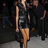 Kaia styled a leather dress with a pair of Ash combat boots and a Stalvey bag.