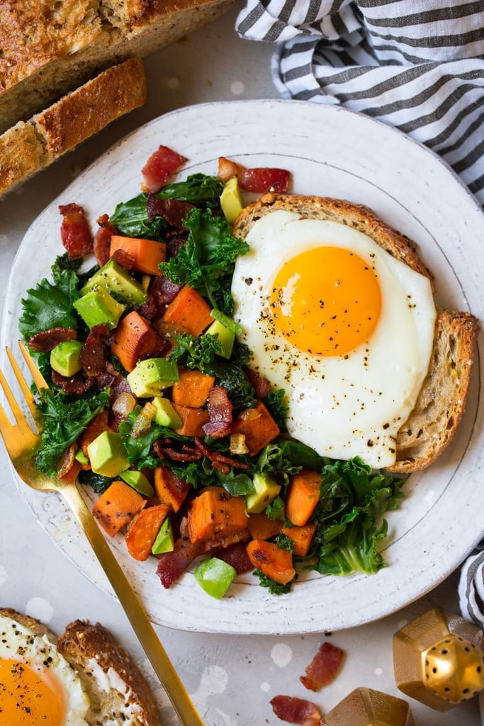 Sweet Potato, Kale, Bacon, and Avocado Hash With Fried Eggs
