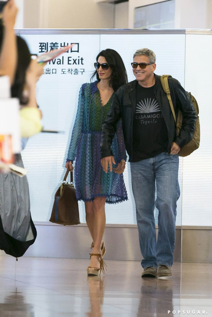 "George Clooney flashed a big grin when he and his wife, Amal Clooney, arrived at Tokyo International Airport on Saturday. The couple held hands as they were greeted by fans, with Amal showing off her style in a colorful sundress and wedges. George stopped to pose for pictures with a few fans, waving back at them as he and Amal made their way through the airport.  It's been a busy few weeks for the actor, who's been making the press rounds to promote his latest film, Tomorrowland. At the movie's Disneyland premiere, George and Amal showed sweet PDA on the red carpet, adding to their long list of sweet moments. In an interview, George told us that fame has been a ""tough adjustment"" for Amal, and he also hinted at what might be ahead in his next chapter. Keep reading for more pictures of the couple's airport arrival, then vote for George in our POP 100 poll for your favorite A-list star."