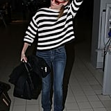 Diane Kruger adjusted her hair while walking through the airport.