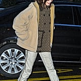 Wearing a Louis Vuitton sweater with camel coat and baby blue combat boots.