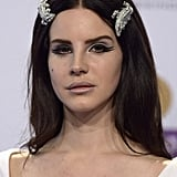 It takes guts to pull off giant lizard-shaped hair pieces, but Lana Del Rey gave it a go with her '60s-style look for the 2013 Echo Awards.