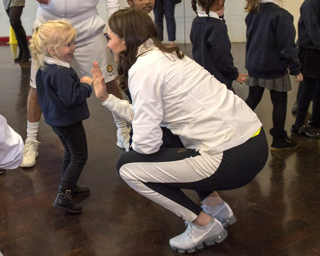 While visiting London's Bond Primary School in January 2018, Kate was all smiles while high-fiving a small girl after a play session.