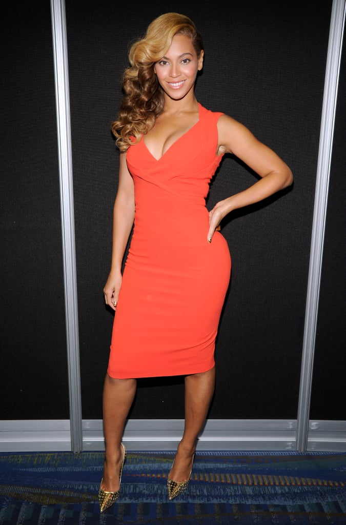 As if she couldn't impress us enough with her LWD, Beyoncé gave us an encore with a second press-conference outfit. She stepped out backstage in another dazzling number: a bright orange knee-length Antonio Berardi dress that she partnered with gold-studded Jimmy Choo pumps.