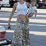 She bared her enviable abs in a printed midi skirt and cropped tank in July 2007.