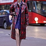Go for the full effect when you style your plaid PVC trench with over-the-knee boots to match.