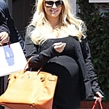 Jessica Simpson smiled after a retail stop in LA.