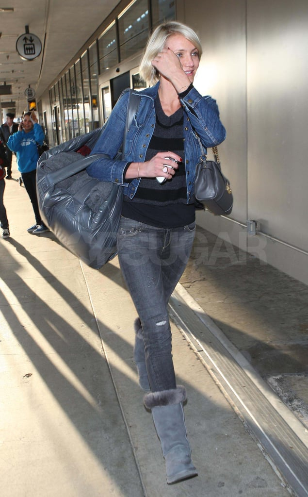 Cameron Diaz carried a huge bag on her shoulder as she arrived at LAX on Sunday. She's been on the go over the last month and was most recently spotted at the Ritz in Philadelphia on Saturday. Cameron's busy travel schedule has taken her to Paris for Fashion Week and London, where she met up with friends Gwyneth Paltrow, Stella McCartney, and Reese Witherspoon for dinner at The Arts Club. Cameron will be back among stylish company when she hits the red carpet as a presenter at this weekend's Academy Awards. Cameron is just one of the stars that is apparently interested in wearing a gown by Victoria Beckham for the big night, though we'll have to wait until Sunday to see if she ends up with a look from the designer.