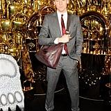 Tom modeled a man bag.