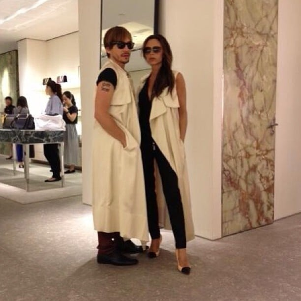 """Victoria Beckham and Ken Paves asked the question """"who wore it best?"""" while trying on the same long vest. Source: Instagram user victoriabeckham"""