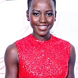 We're used to seeing Lupita Nyong'o done up in bold makeup hues, but her look at the Paris premiere of 12 Years a Slave proves that radiant skin is always a glowing look.