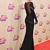 Miley Cyrus wore a sexy black gown on the red carpet at the VMAs.