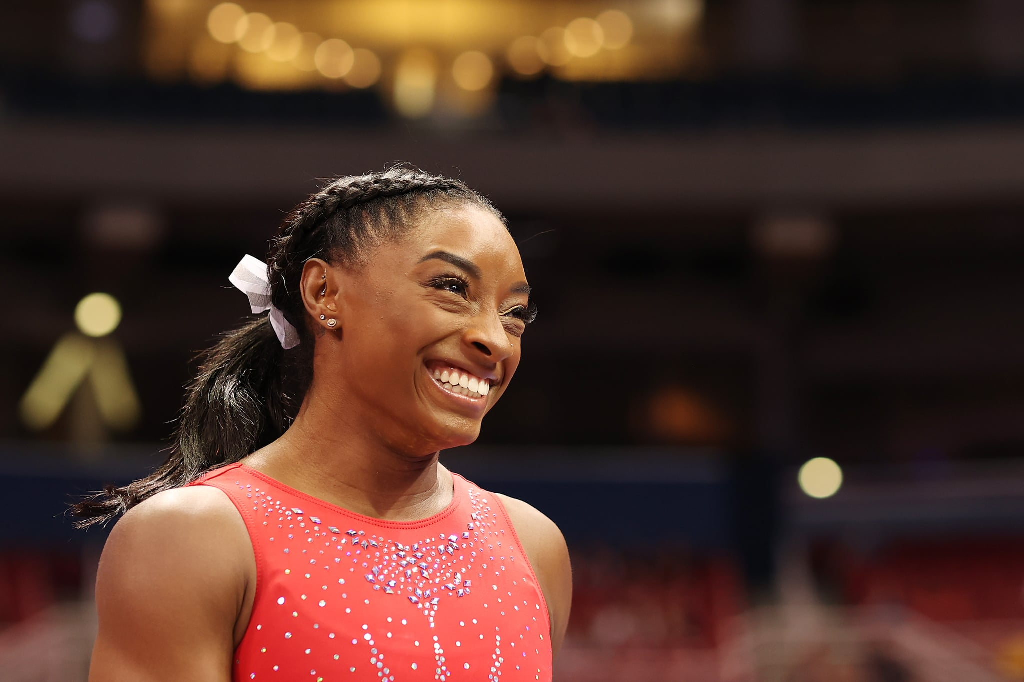 ST LOUIS, MISSOURI - JUNE 27: Simone Biles reacts during warm ups prior to the Women's competition of the 2021 U.S. Gymnastics Olympic Trials at America's Centre on June 27, 2021 in St Louis, Missouri. (Photo by Carmen Mandato/Getty Images)