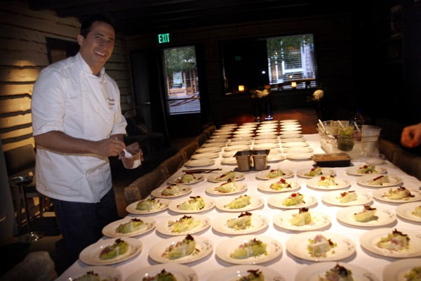 Chef Lee had to make a lot of plates! Here, he's assembling the first course: a modern take on the classic wedge salad. It consisted of iceberg lettuce, smoked bacon, oven-dried tomatoes, cucumbers, black olives, and blue cheese.
