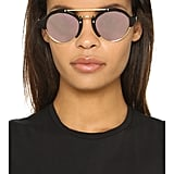 These Illesteva shades are cute, unique, and perfect for a sunny park day.  llesteva Milan II Mirrored Sunglasses ($300)