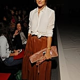 Leave it to Olivia to give us a new favorite way to wear leather. At the Norisol Ferrari show in NYC, Olivia gave leather a ladylike spin with a vintage leather midi skirt and a white blouse, which she finished with understated Tibi ankle-strap heels.