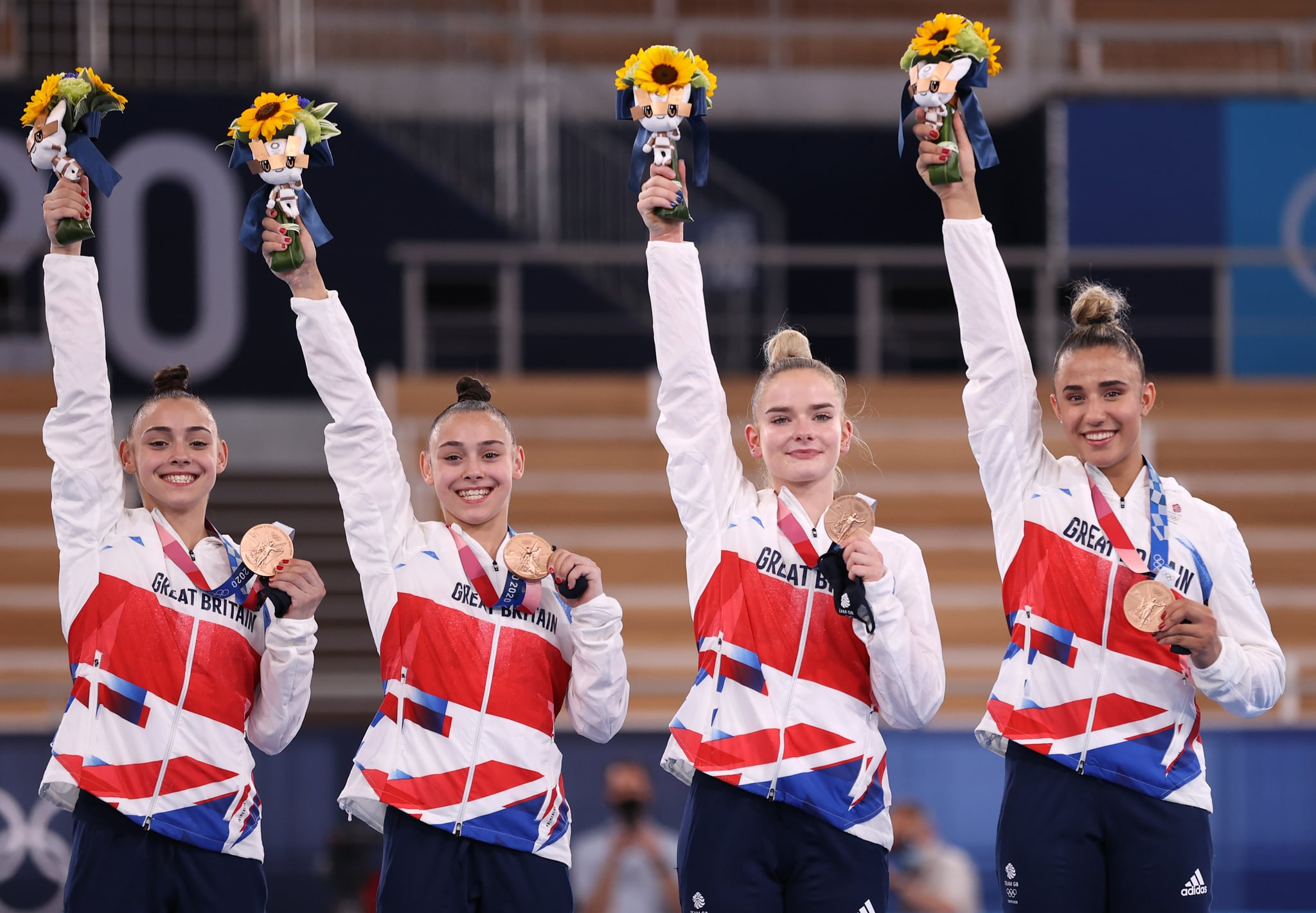 TOKYO, JAPAN - JULY 27: Team Great Britain celebrates after winning the bronze medal during the Women's Team Final on day four of the Tokyo 2020 Olympic Games at Ariake Gymnastics Centre on July 27, 2021 in Tokyo, Japan. (Photo by Laurence Griffiths/Getty Images)