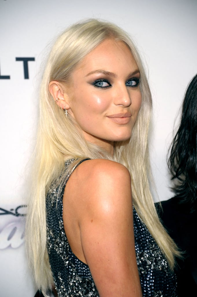 Debuting a new platinum hair color, Candice Swanepoel lined her eyes for a smoky look.