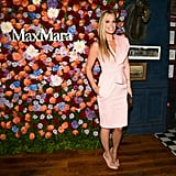 Looking lovely as Max Mara's floral backdrop, Molly Sims was pretty in pink.