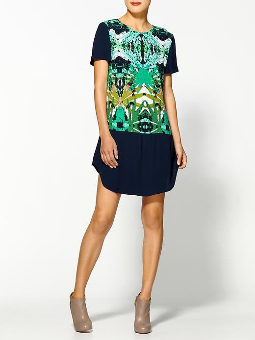 This Sam & Lavi paradise print dress ($168) is one of the most unique printed dresses we've seen in a while. Sport it with leggings and booties now, then sandals when the temps warm up.