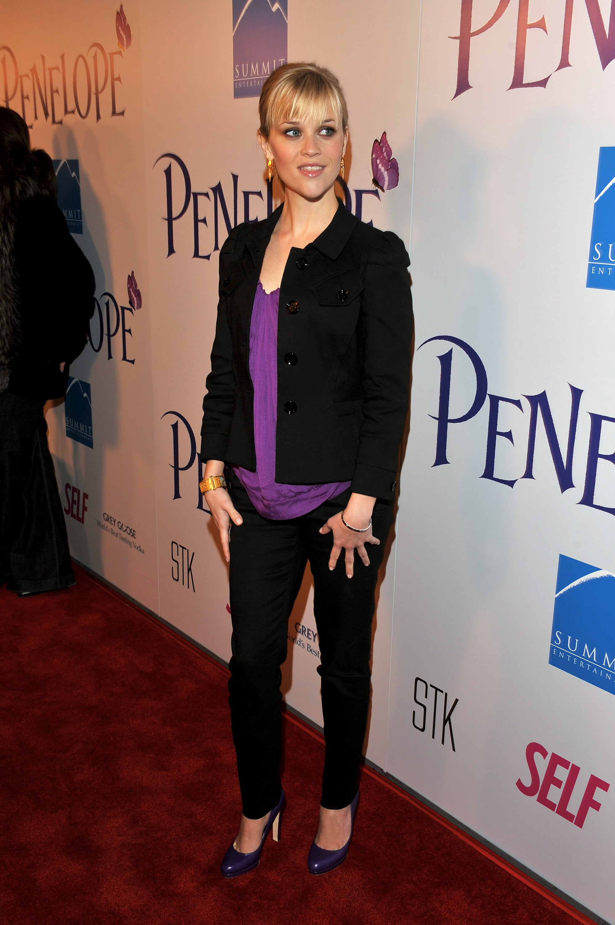 For the premiere of her production debut, Penelope, Reese went dressy casual in a purple tee, black pants, and a blazer.