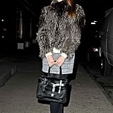 A furry topper, tweed skirt, and Reed Krakoff bag were the stars of this street-style moment.