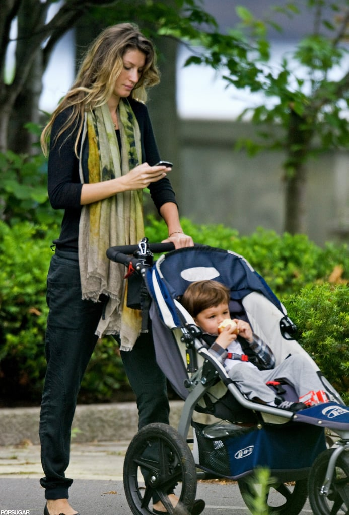 """Gisele Bundchen checked her phone as she pushed Benjamin Brady to a Boston park today. Ben snacked on an apple before hitting the sandbox, where he rode the swings with his mom. Gisele and Ben visited the playground together last week too, as they kicked off the long holiday weekend. They're staying put on the East Coast while Tom Brady works out with his New England Patriots teammates. Tom mocked his """"Boston accent"""" in a recent Funny or Die video, which also highlighted the fact that Tom is actually from California.  The official NFL preseason starts in August, but Tom and his family may also be gearing up for another development. Rumors that Gisele is pregnant with her second child started circulating recently, though the couple have yet to comment on the news."""